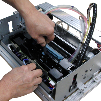 Label printer assembly thumb