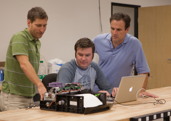 NOVO engineers working on a page-wide array graphics printer