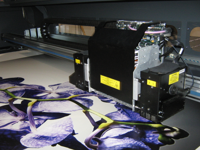Grand-format UV printer printing flowers while under development